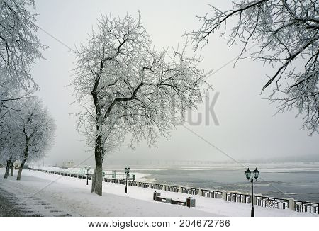 Winter in the city, coast of river