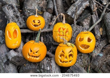 Halloween Themes. Composition Of Six Carved Halloween Pumpkins On Wooden Background. Pumpkins With D