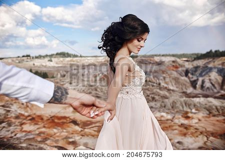 Follow Me. Couple In Love Holding Hands. Woman Leads The Man. Mountains Of Mars On Earth, Fabulous S