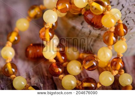 Amber Beads Accessory On Stone Background