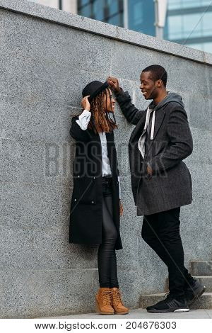 Fun leisure time. Black happy young couple. Active African American people first date, fashion street style, happiness concept