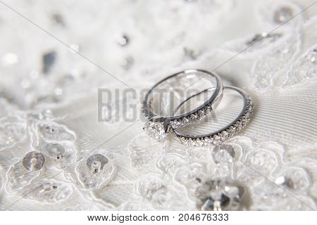 two wedding rings with diamond on platinum rings