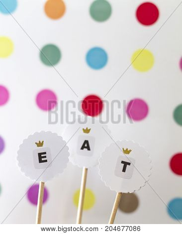 Toppers for cake decoration on polka dot backstage