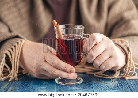 Hot Alcohol Drink, Mulled Wine With Spices In Male Hand