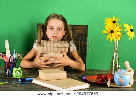Kid And School Supplies, Green Background. Girl With Bored Face