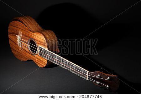 Traditional koa wood ukulele. Hawaiian uke musical instrument.