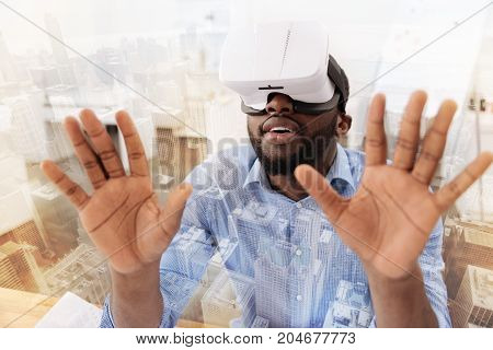 Another reality. Close up of relaxed African American keeping palms up and experiencing pleasant emotions while wearing virtual mask