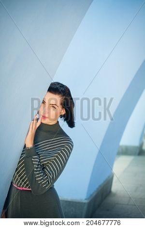 Modest Beautiful Woman On The Background Of A Wall Of Fire