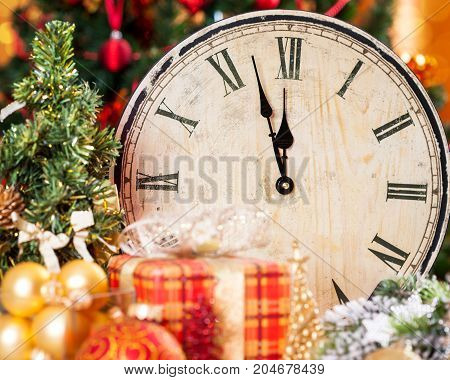 Vintage wooden clock and Christmas decorations background