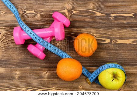 Fitness Concept, Dumbbells Weight With Measuring Tape, Orange And Apple