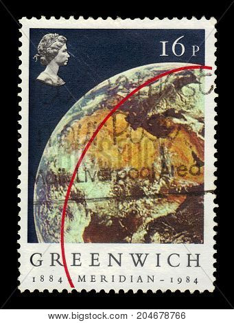 UNITED KINGDOM - CIRCA 1984: A stamp printed in UK shows portrait of Elizabeth II and Earth (View from Apollo 11), inscriptions Greenwich Meridian, series сentenery of the Greenwich Meridian, circa 1984