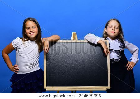 Classroom And Back To School Concept. Kids Wearing School Clothes