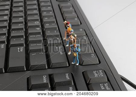 Backpackers On Top Of The Keyboard. Macro Photo