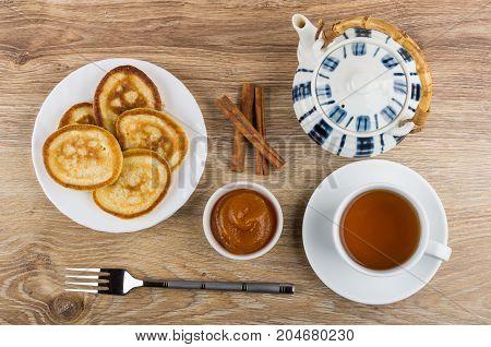 Pancakes, Teapot, Cinnamon Sticks, Apricot Jam And Cup Of Tea