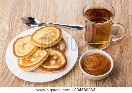 Tea In Transparent Cup, Pancakes, Bowls With Apricot Jam