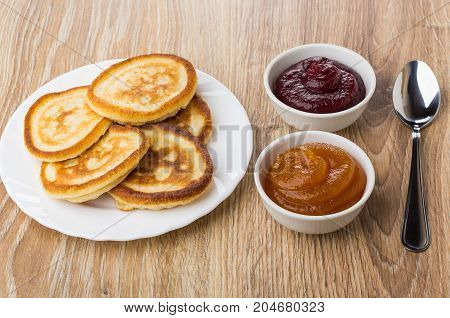Pancakes In Plate, Bowls With Apricot And Raspberry Jam, Teaspoon