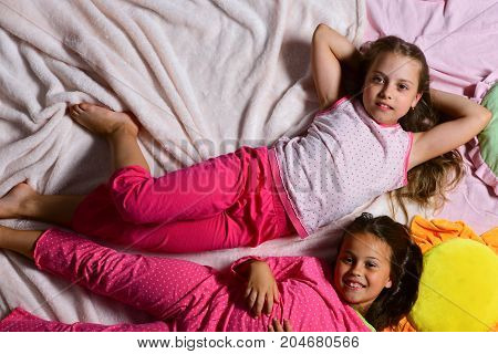Kids With Smiling Faces Have Rest In Bed