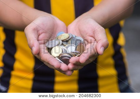 Close up hand full of coin. saving concept