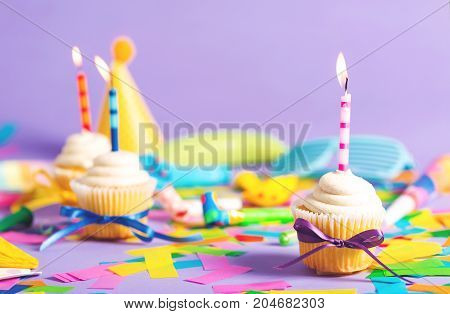 Celebration theme filled with party accessorieson a purple background