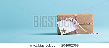 Present box with tag on a blue background