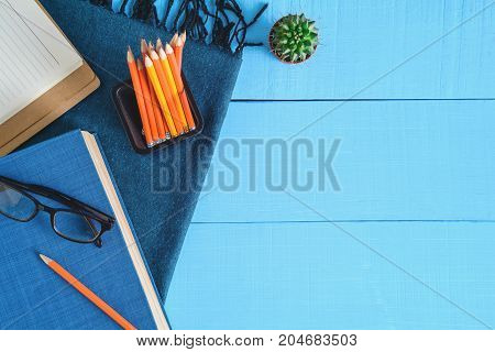 Top View Book And Pencil Note On Blue Wood Table