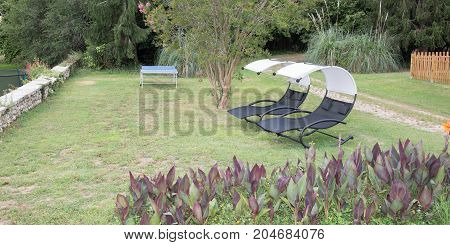 Two Empty Chairs On The Grass Backyard Garden Idyll