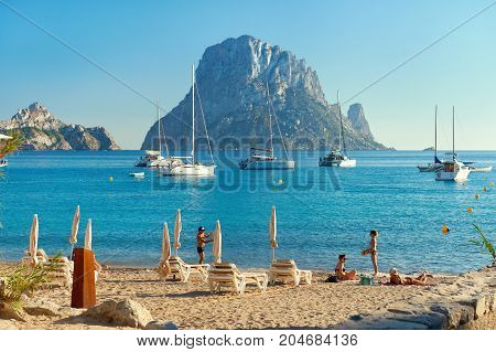 Ibiza Island Spain - June 12 2017: Cala d'Hort beach. Cala d'Hort in summer is extremely popular beach have a fantastic view of the mysterious island of Es Vedra. Ibiza Island Balearic Islands. Spain