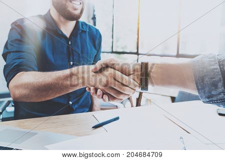Business partnership handshake concept.Photo two businessman handshaking process.Successful deal after great meeting.Horizontal, blurred background