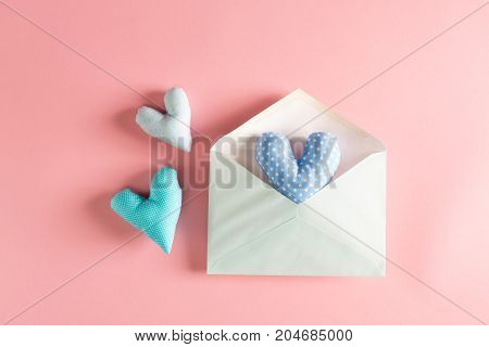 Heart shaped cushions coming out of a gift envelope - love and Valentine's Day theme