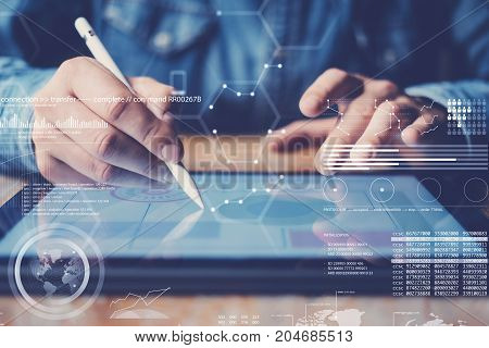 Concept of virtual diagram, graph interfaces, digital display, connections icon.Man using stylus pencil on display of contemporary electronic tablet.Blurred background. Horizontal