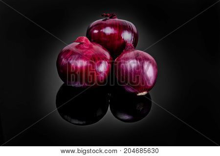 Shallots On Black Background With Reflect Onion Bulb.