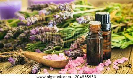 Fresh Lavender, Essential Oil And Bath Salt On Wooden Background