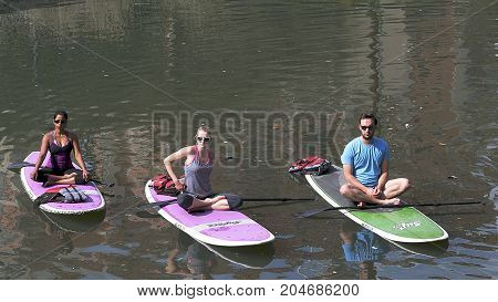 San Antonio, Texas - November 12, 2017: Yoga lesson on surfboard in San Antonio, Texas