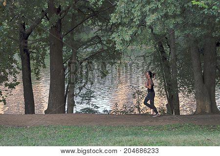 Austin, Texas - November 13, 2016: People jogging on river path in Austin, Texas.