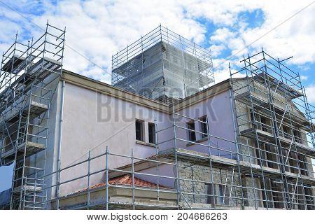 Iron construction scaffolding. Building facade white black photo