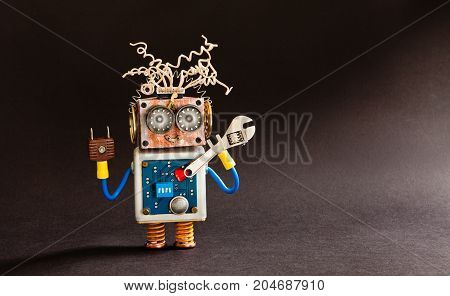 Crazy serviceman robot ready with adjustable spanner. Creative design cyborg toy, electric wires hairstyle, big eyeglasses, electronic circuit body, red heart. black background copy space.