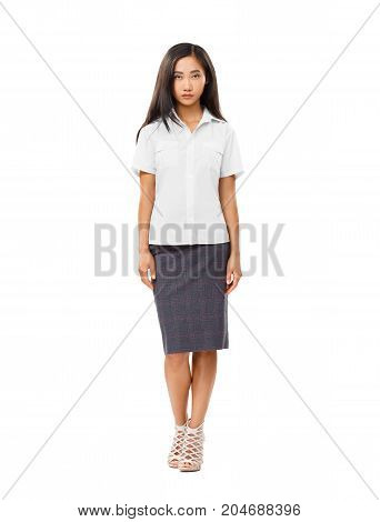 Serious Asian Young Woman In Full Length Isolated On White