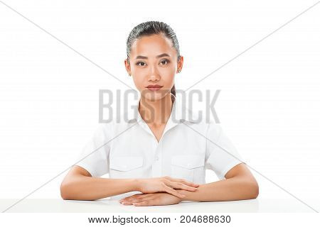 Pretty Smiling Asian Girl In White Shirt Sitting At Table