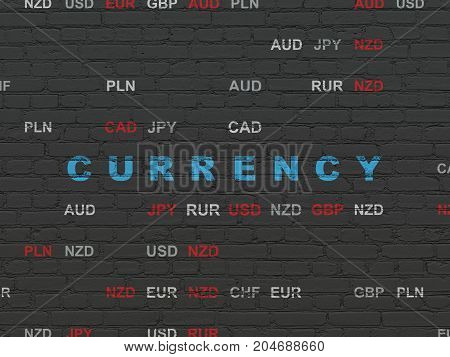 Currency concept: Painted blue text Currency on Black Brick wall background with Currency