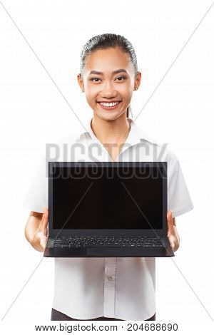 Portrait isolated of cute Asian young smiling woman holding and showing laptop. Black netbook with blank screen. Photo suitable for presentation computers advertising sales and other design needs