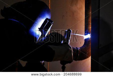 worker wear safety mask welding steel for background