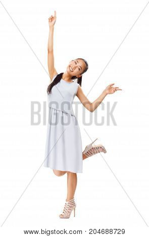 Young Energetic Asian Girl In Elegant Dress Enjoys Life