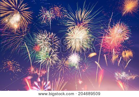 colorful fireworks on blue and purple twilight background to celebrate new year or special occasions