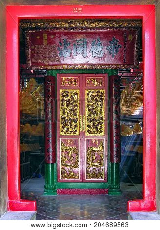 Sheung Wan, Hong Kong - March 25, 2003: Extensively decorated entrance to the Man Mo Temple in the Sheung Wan district in Hong Kong.