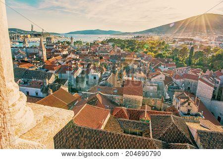 Historic town Trogir from Cathedral of St. Lawrence Unesco Croatia sunset scene. Travel destination. Architectural scene. Summer vacation. Retro photo filter.