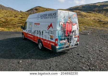 Iceland August 24 2017: Glacier Walks van is parked near the head of a trail that leads to a mountain glacier. Glacier Walks provides guided tours on glaciers.