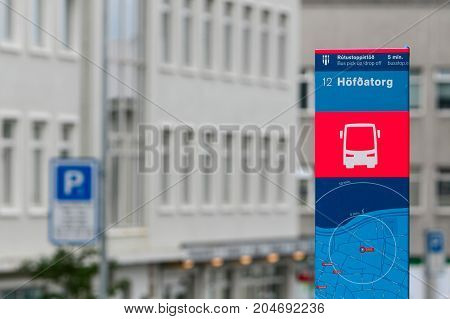 Colorful bus stop marker in Reykjavik .