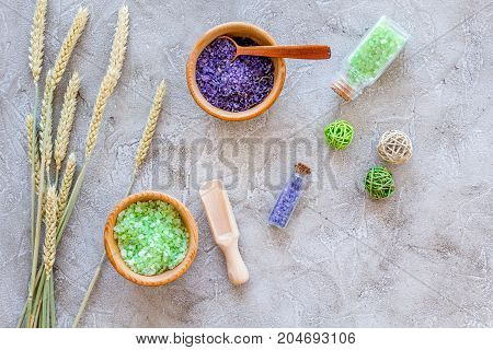 bath salt in herbal cosmetic set with wheat on stone desk background top view