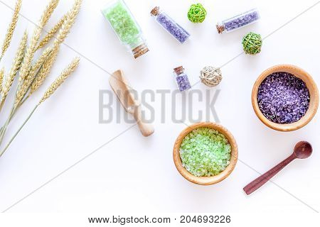 bath salt in herbal cosmetic set with wheat on white desk background top view space for text