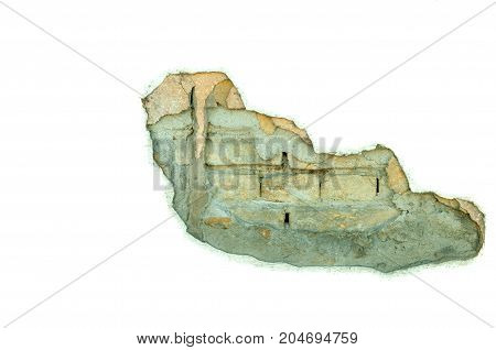 Partially isolated damaged wall of house with hole in the plaster and brick background